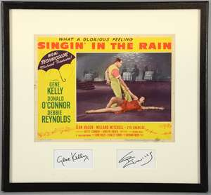Singin' In The Rain (1952) US Lobby card, mounted with signatures of Gene Kelly & Cyd Charisse, framed, 17 x 18 inches