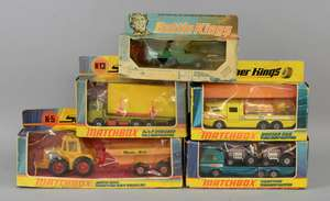 Matchbox Battle Kings M3A1 Half Track (K-108), Super Kings Muir-Hill Tractor and Trailer (K-5), Racing Car Transporter (K-7), DAF Building Transporter (K-13) and Tractor Transporter (K-21), together with a quantity of mostly boxed Matchbox models. (q