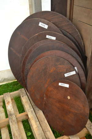 Selection of solid mahogany round table tops and walnut veneered boards   Please note: There is no Brazilian rosewood in the auction but Ewbank's advises prospective purchasers who intend to ship this lot to another country that they must familiarise