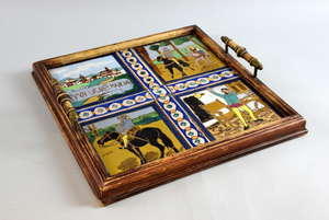 An oak two handled tray set with four majolica tiles one  with Don Quixote 34 x 34 cm