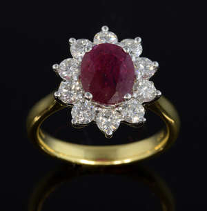 Burma ruby and diamond cluster ring, oval cut ruby of 2.28 carats within a surround of ten round brilliant cut diamonds, in 18 ct yellow gold. Ruby certificated by IGI stating the ruby origin as Burma and free of treatment.  Estimated total diamond w