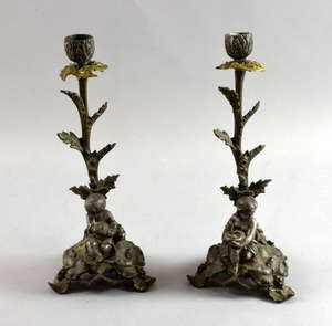 Pair of spelter figural candle sticks.