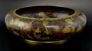 20th century Chinese cloisonne bowl decorated with flowers and foliage, 38.5cm diameter,