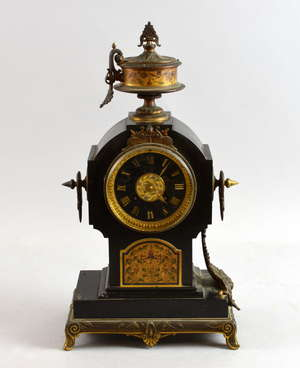Black slate and ormolu mantle clock, the face with champlevé panel by W. Gibson, Paris, maker's mark  'G S' - Georges Emile Henri Servant and Medaille D'Or 1867, serial number 2834, 40.5cm high (one handle lacking on urn finial)