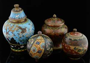 Chinese cloisonne spherical jar and cover decorated with alternating panels of butterflies and flowers and foliage, on three bun feet, 10.5cm high, and three other jars and covers, (4),