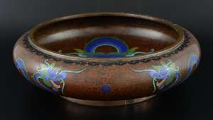 Chinese cloisonne bowl the brown ground decorated with a dragon chasing the flaming pearl, four character mark to base, aperture 23cm diameter,