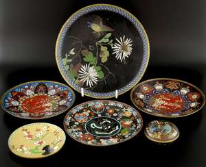 Chinese cloisonne circular pot and cover decorated with a main panel of Irises and other flowers and objects,  7.5cm diameter, and five plates, (6),