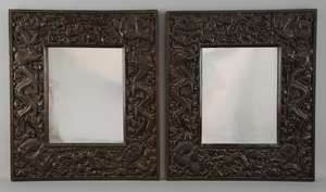 Pair of Chinese hardwood framed mirrors carved with dragons, each 50cm x 43.5cm,