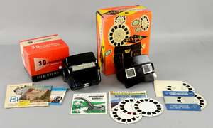 Ray Harryhausen - Two personal View-Masters in original boxes, one 'Sawyer's gift.pak view-master' made from Bakelite & the other a 'Model-D', with five discs of Dinosaurs & Battle of The Monsters. Provenance - Given by Ray Harryhausen to Tony Dalton