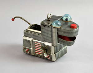 A vintage KO Japan tin plate clockwork robot dog.