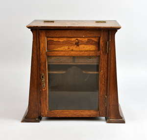 Arts and Crafts smokers oak cabinet with parquetry panel of a seated fisherman. 33cm high x 18cm deep