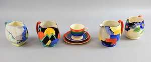 Susie Cooper for Gray's Pottery 'Moon and Mountains' pattern 7960 Paris jug circa late 1920s, a similar Cubist pattern 8071 jug, another Gray's Pottery jug and a coffee can, saucer, and side plate set.