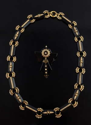 Victorian black onyx necklace and brooch suite, with half seed pearls and gold mounts, C 1860,  length 18 cm and brooch, 5 x 4 cm