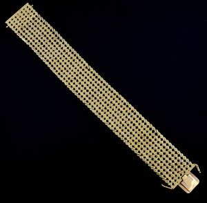 Vintage gold bracelet, of articulated flat weave, marked 750 for 18 ct gold, 18 cm