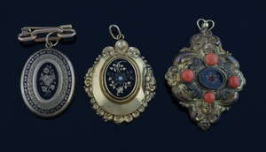 Three 19th C lockets and pendants, gold pendant with niello work, another gilt metal set with coral and one with black enamel, gold and mixed metals  (3)