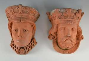 Pair of terracotta planters in the form of heads,
