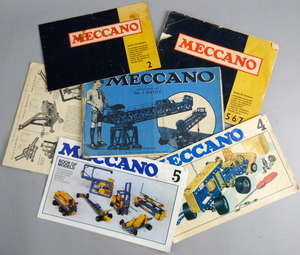 Mecanno in green and blue with nuts and bolts in  two  wooden trunks,and a small quantity of magazines