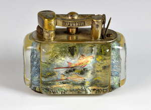 A Dunhill Aquarium table lighter, the lucite panels decorated with fish and aquatic foliage. 8cm x10cm