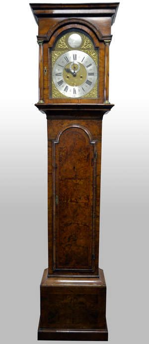 18th century Walnut long case clock by Francis Reynolds, Kensington,  12 inch arched brass dial with silvered chapter rings, cast brass spandrels and blue steel hand. Signed Francis Reynolds, Kensington in the silvered boss in the arch. The eight day