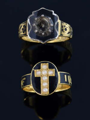 Two 19th C gold mourning rings with black enamel one with seed pearls