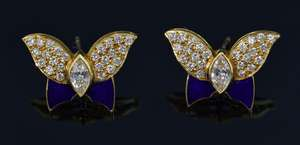 A pair of 18ct gold, blue enamel and diamond butterfly earrings, set with a marquise cut diamond to the body weighing approximately 0.25 carats with pave set diamond wings and blue enamel. Hallmarked 18ct gold.