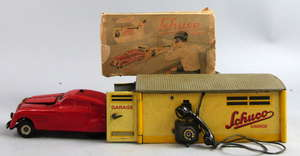 Schuco tinplate garage with car, and a Mighty Midget Construction kit,