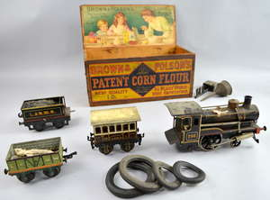 Tin plate locomotive with accessories, in wooden box
