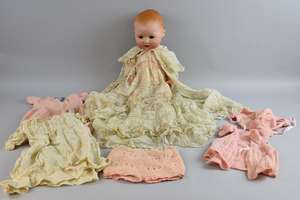 German Armand Marseille bisque headed  doll  No 531/8K, and a quantity of cloths