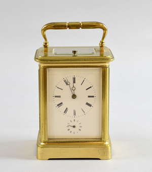 Late 19th century brass and four glass carriage clock with lever movement, repeat and alarm, striking on a bell, 16.5cm high, in original carrying case, with two keys,