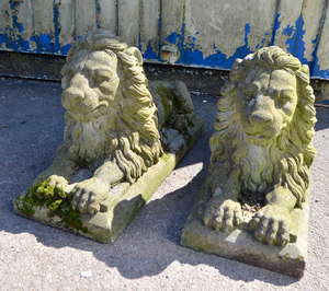 Pair of composition  stone lions couchant on rectangular bases, 80cm long