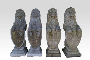 Set of four composition stone lions sejant with shields in relief, 90 cm high