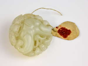 Chinese white jade carving of a bat and dragonfly on Lingzhi mushrooms, 5cm wide,