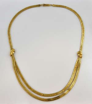 Gold double row chevron link necklace, with leaf detailing, box clasp with figure of eight safety catch, stamped 18ct, measuring approximately 18 inches in length