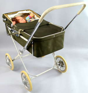 Silver green hood cross frame pram with three plastic bodied dolls, circa 1960 +