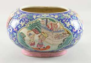 19th century Chinese famille rose rectangular rounded bowl with inturned rim decorated with figures in interiors on a flower strewn blue ground, 18.5cm high, overall width 32cm, drilled