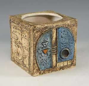 Troika cube form vase  with  mainly blue and orange decoration on a cream ground, signed EW for  Eleanor Winning   15 x 15 cm