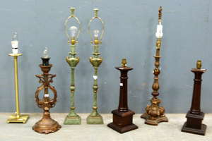Seven various table lamps with shades and a chandelier