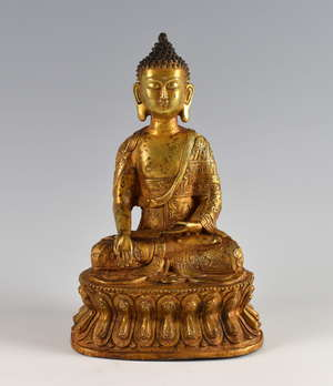 Chinese gilt bronze Buddha on double lotus throne, Kangxi six character mark but later, 28.5cm high, PROVENANCE: Acquired by the vendors great grandfather in Harbin, China in the early 20th century when working as a train driver and has been in the f