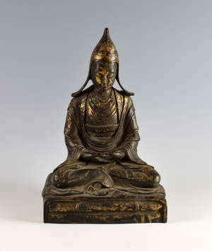 Sino-Tibetan cast bronze figure of Tsongkhapa on rectangular throne, with remnants of gilt and red lacquered decoration, reverse of base with Qian Long mark and possibly of the period, 38cm high, PROVENANCE: Bought in China by Dr. E. R. Wheeler in 19
