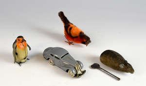 Schuco 1001 clockwork car, mouse and pecking bird and a German tinplate clockwork penguin.