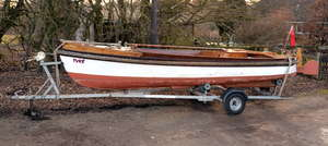 1930's steel hulled 18' traditional open river launch boat Tyke, with later glass fibre sheathing, two stroke petrol inboard engine by Stuart Turner, type P55M, No. 20462, driving a three blade propeller, with road trailer, overall cover, instructi