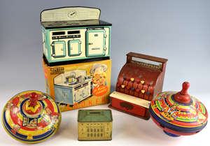 Chubb & Sons, Queens Dolls House money box, Mettoy Toy Cooker in original box, two spinning tops and a shop till