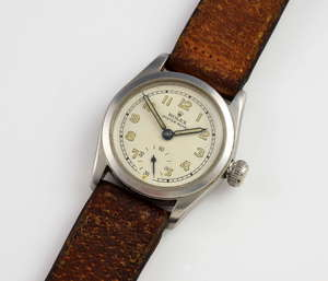 Rolex Oyster Royal wrist watch, the steel case with  white dial, Arabic numerals and subsidiary seconds dial at 6, the crown marked patent oyster, the case back marked 75946 , mounted on a brown leather strap  circa 1954