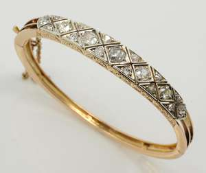 Victorian diamond set bangle, old cut diamonds, estimated total diamond weight 2.05 carats, estimated colour I-K and clarity I, mounted in yellow metal testing as 15 ct, with hidden clasp and safety chain