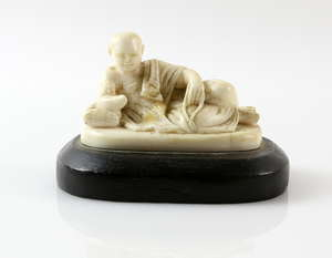 b2baf8e2223b Early 20th century Chinese carved ivory figure of a man reclining